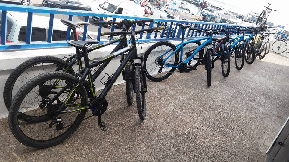 MTBs lined up outside the shop